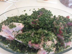 Raw chicken pieces coated in herb paste